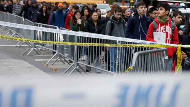 PHOTO: Students walk past police line tape on their way to school a day after a man driving a rented pickup truck mowed down pedestrians and cyclists on a bike path alongside the Hudson River in New York City, Nov. 1, 2017. (Shannon Stapleton/Reuters)