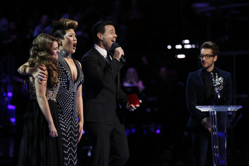 "In this photo provided by NBC, Tessanne Chin, second from left, and Jacquie Lee, left, react as Carson Daly announces Chin as the season five winner of ""The Voice"" on Tuesday, Dec. 17, 2013, in Los Angeles. The 28-year-old Kingston native had nearly given up on her dreams before landing a spot on the NBC singing competition. Chin's coach, Maroon 5 frontman Adam Levine, was also thankful to add a second win to his resume. Will Champlin stands at right. (AP Photo/NBC, Trae Patton)"