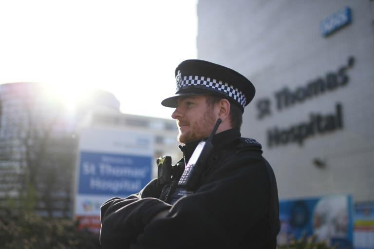 A police officer stands guard at St Thomas' hospital in central London where Britain's Prime Minister Boris Johnson is in intensive care