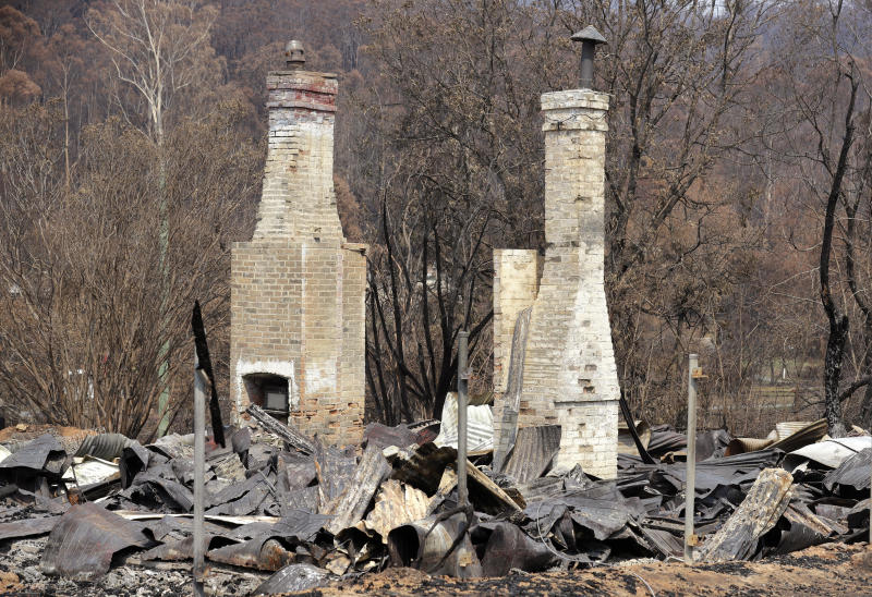 Two brick fireplaces are all that are left of a historic town store at Nerrigundah, Australia, Monday, Jan. 13, 2020, after a wildfire ripped through the town on New Year's Eve. The tiny village of Nerrigundah in New South Wales has been among the hardest hit by Australia's devastating wildfires, with about two thirds of the homes destroyed and a 71-year-old man killed. (AP Photo/Rick Rycroft)