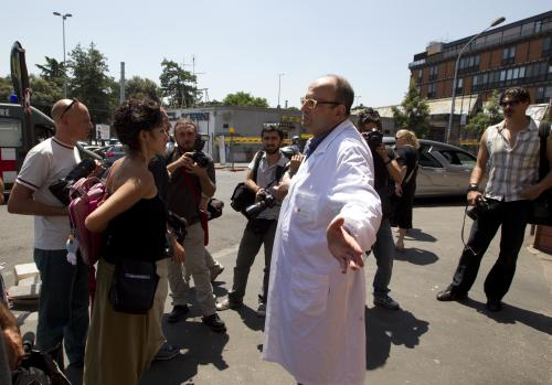 Coroner Antonio Spasola speaks to the media outside the morgue of Policlinico Umberto I hospital where the body of actor James Gandolfini was brought after he died late Wednesday in Rome,Thursday, June 20, 2013. Gandolfini died after suffering a cardiac arrest while vacationing in Rome. Claudio Morini, head of the hospital's emergency room, said Gandolfini arrived at the hospital at 10:40 p.m. (2040 GMT, 4:40 p.m. EDT) Wednesday and was pronounced dead at 11 p.m. after resuscitation efforts in the ambulance and hospital failed. (AP Photo/Alessandra Tarantino)