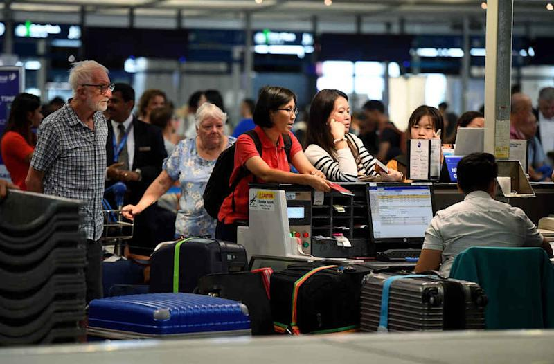 Passengers check in for their flights at KLIA in Sepang August 23, 2019. — Bernama pic