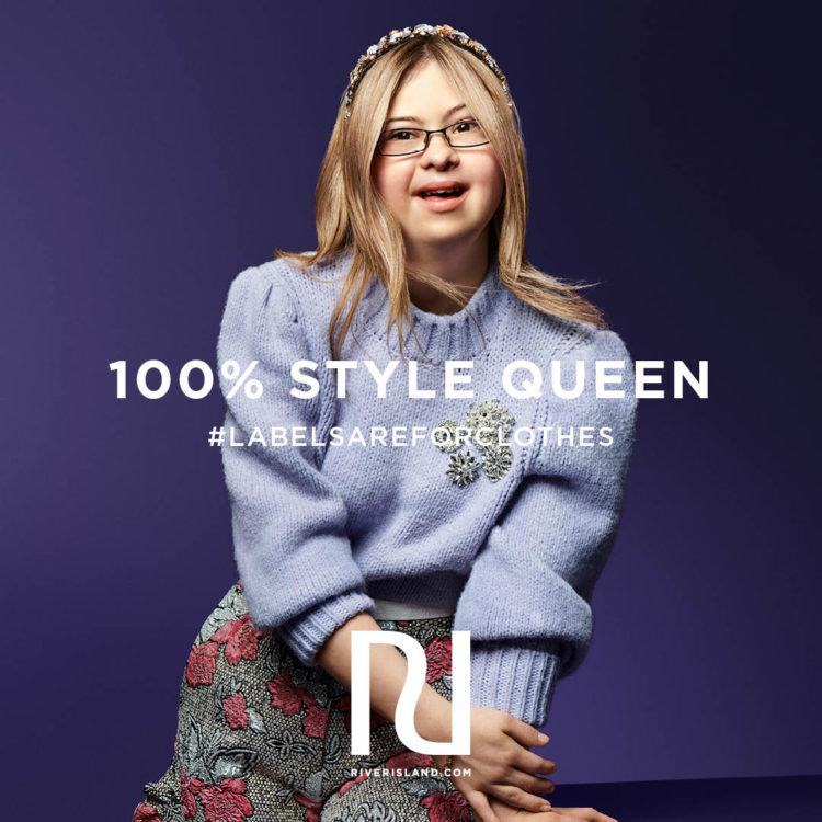 Advertisement featuring Kathleen Humberstone, woman with Down syndrome. She is sitting and smiling at the camera.
