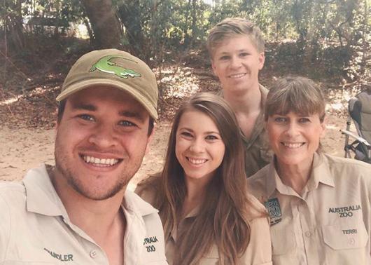 Bindi Irwin, Chandler Powell, Robert Irwin and mum Terri Irwin pose in khaki at camp in bush