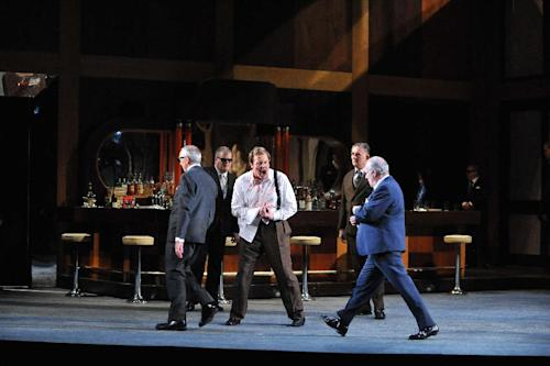 "This undated image released by the English National Opera shows James Gower as Ceprano, center, in a production of ""Rigoletto."" The British director Jonathan Miller famously reinvented ""Rigoletto"" for his 1982 staging at the English National Opera, moving it to Little Italy in the 1950s. Inspired by ""The Godfather"" movies and the film ""Some Like It Hot,"" Miller turned the Duke into a mafia boss and Rigoletto into a waiter at a mob hangout. (AP Photo/English National Opera, Chris Christodoulou)"