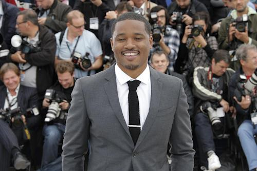 """FILE - This May 16, 2013 file photo, director Ryan Coogler poses for photographers during a photo call for the film """"Fruitvale Station"""" at the 66th international film festival, in Cannes, southern France. Coogler's """"Fruitvale Station"""" _ his first dramatic feature and first project since graduating with a master's degree in 2011 _ won both jury and audience awards at the Sundance Film Festival, and attended the Cannes Film Festival. (AP Photo/Francois Mori, file)"""