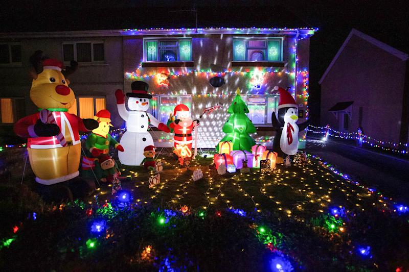 The neighbours say the lights have brought some cheer to the street. (SWNS)