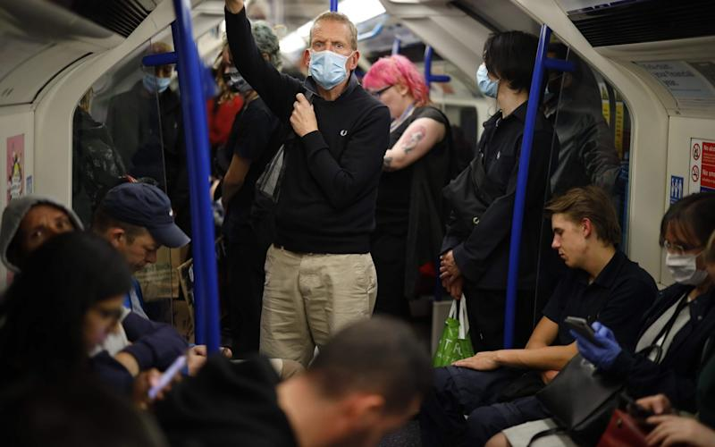 Commuters on the Victoria line in London this week