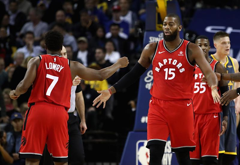 OAKLAND, CA - DECEMBER 12: Greg Monroe #15 of the Toronto Raptors is congratulated by Kyle Lowry #7 after he was fouled by the Golden State Warriors at ORACLE Arena on December 12, 2018 in Oakland, California. NOTE TO USER: User expressly acknowledges and agrees that, by downloading and or using this photograph, User is consenting to the terms and conditions of the Getty Images License Agreement. (Photo by Ezra Shaw/Getty Images)