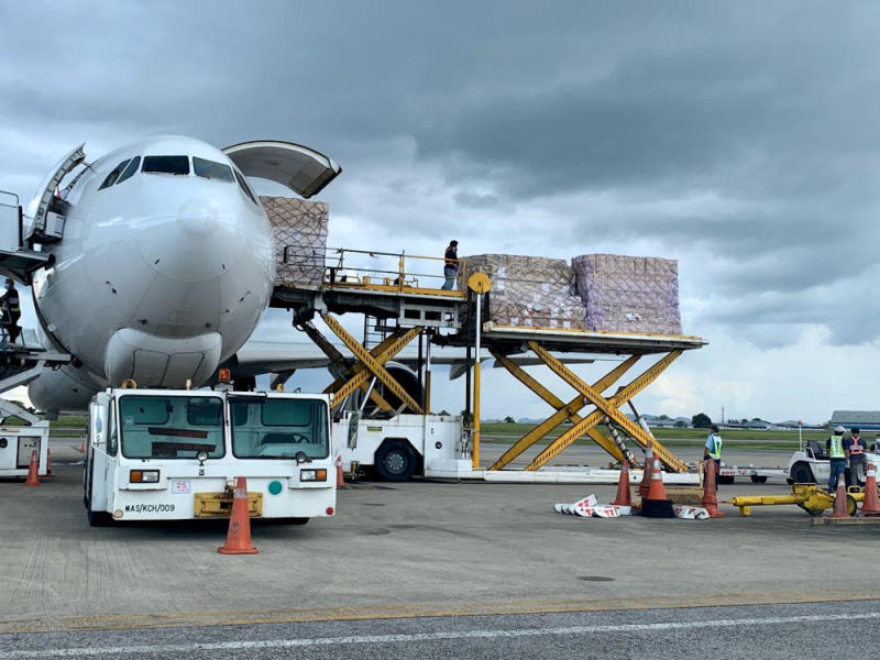 The unloading of the personal protective equipment from the plane at the Kuching International Airport, April 9, 2020. — Picture courtesy of Sarawak Public Communications Unit (UKAS)