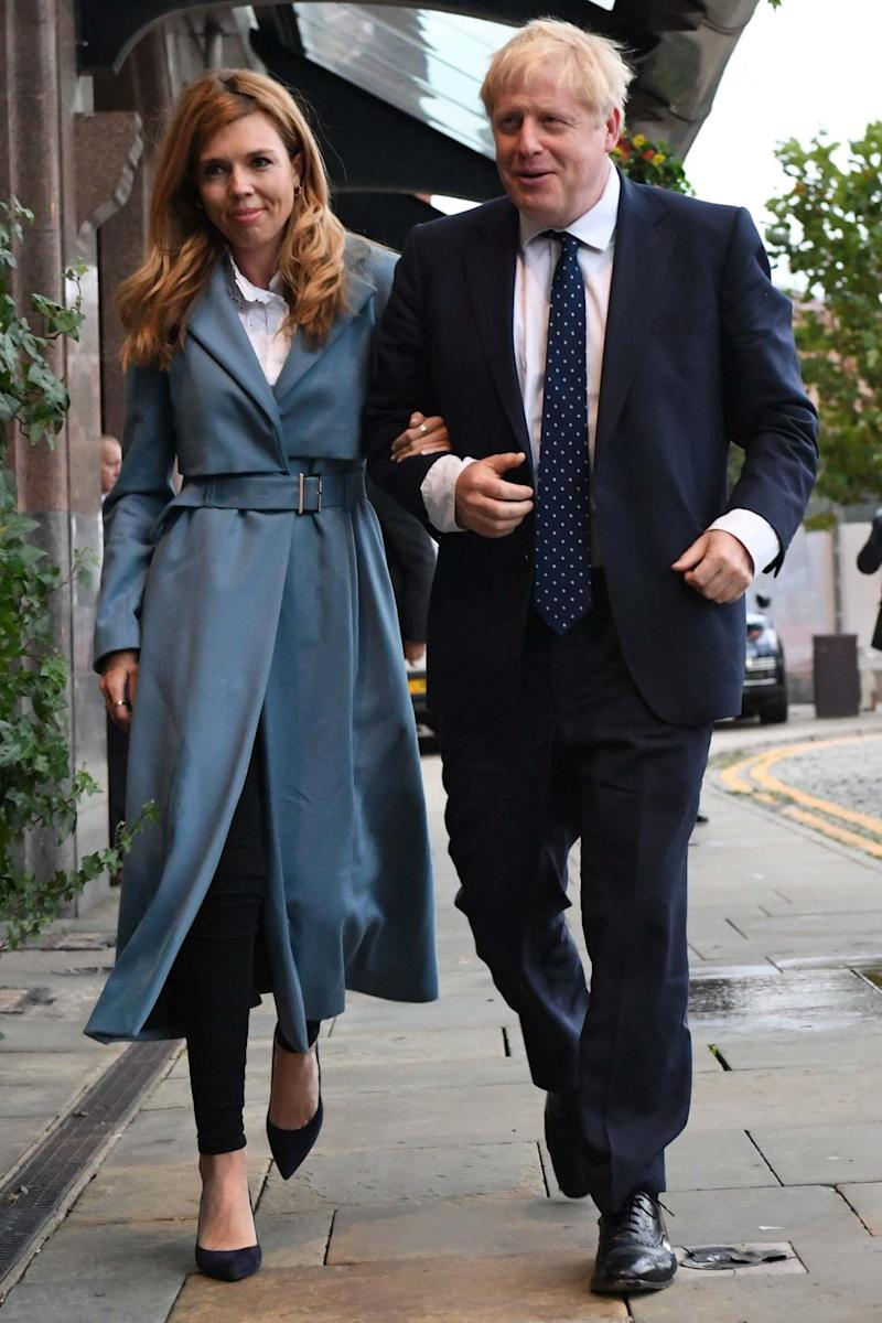 Lockdown plans: Boris Johnson with fiancée Carrie Symonds (PA)