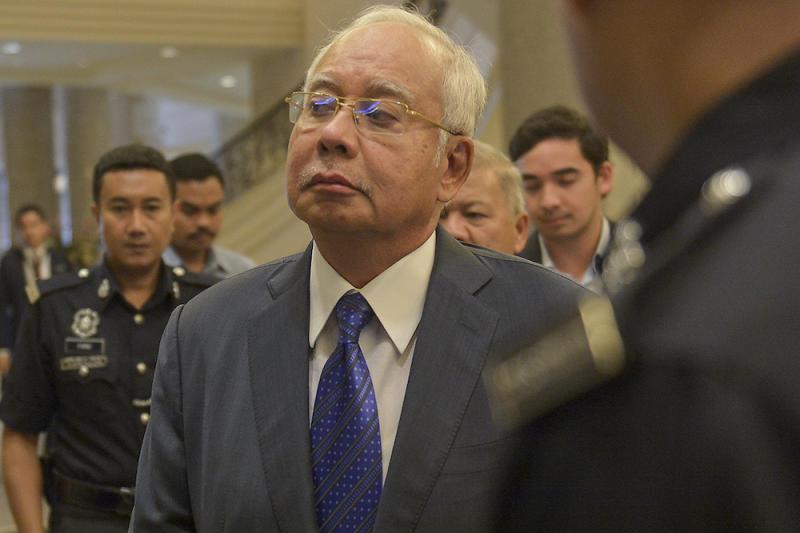 Datuk Seri Najib Razak and his son Noorashman Najib are seen at the Palace of Justice in Putrajaya February 11, 2019. — Picture by Mukhriz Hazim