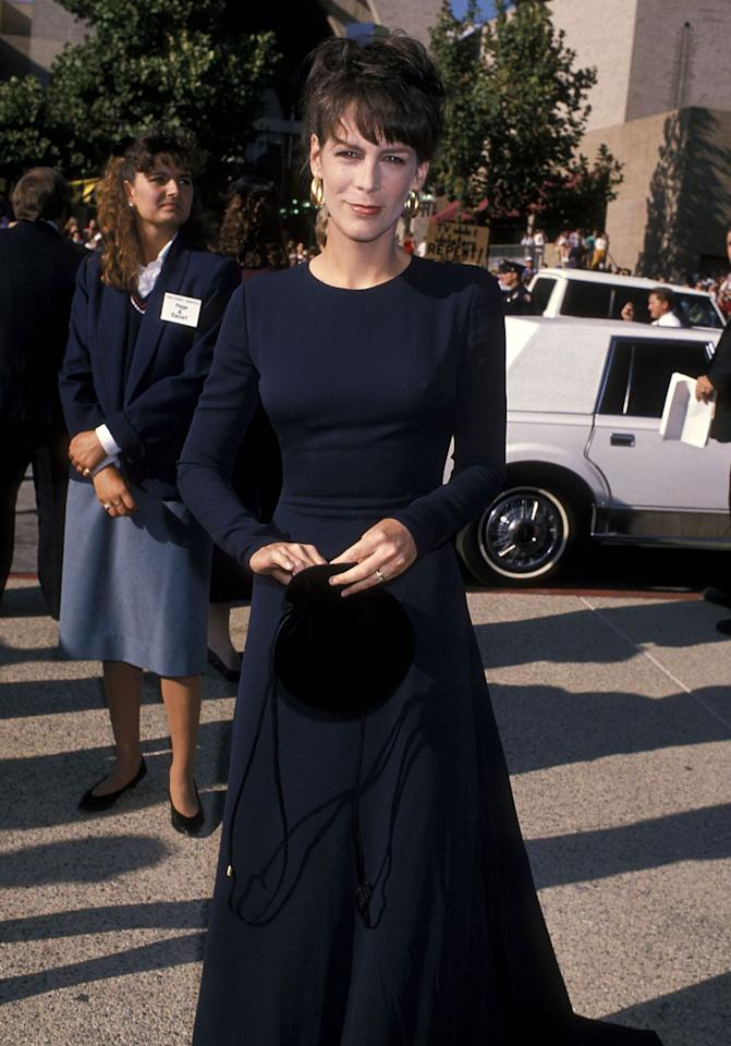 """<p>The """"Halloween"""" star wore a simple, long-sleeved black dress with gold hoop earrings. Honestly, she could still rock this look today!</p>"""
