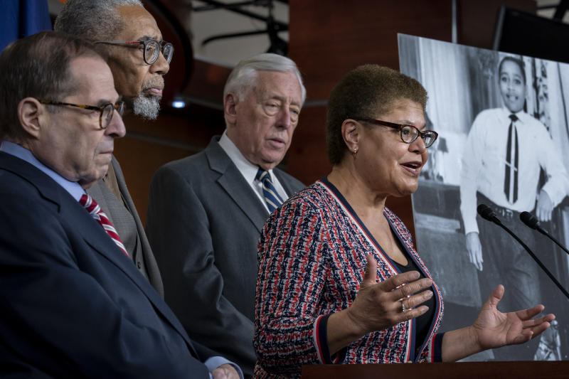 """From left, House Judiciary Committee Chairman Jerrold Nadler, D-N.Y., Rep. Bobby Rush, D-Ill., House Majority Leader Steny Hoyer, D-Md., and Rep. Karen Bass, D-Calif., chair of the Congressional Black Caucus, hold a news conference to discuss the """"Emmett Till Antilynching Act"""" which would designate lynching as a hate crime under federal law, on Capitol Hill in Washington, Wednesday, Feb. 26, 2020. Emmett Till, pictured at right, was a 14-year-old African-American who was lynched in Mississippi in 1955, after being accused of offending a white woman in her family's grocery store. (AP Photo/J. Scott Applewhite)"""