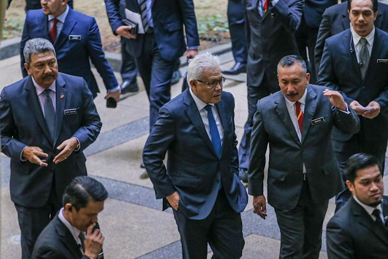 Home Minister Datuk Seri Hamzah Zainudin (centre) is pictured during a visit to the National Registration Department in Putrajaya July 20, 2020. — Picture by Hari Anggara