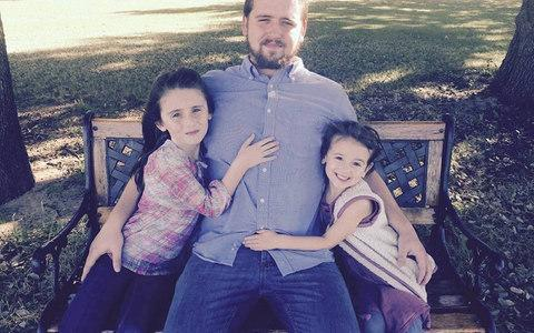 """Daniel Shaver (pictured with his daughters) was heard saying """"please don't shoot me, please don't shot me"""", according to audio heard on a police video of the incident"""