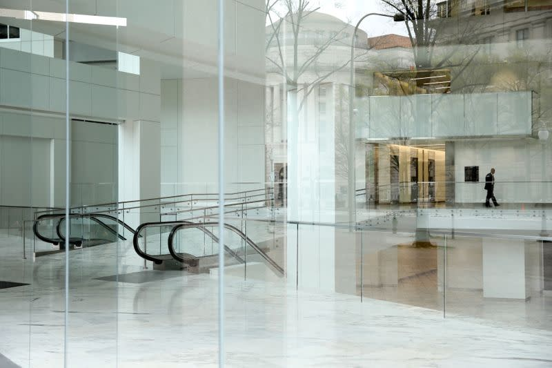 FILE PHOTO: A security guard keeps watch over an empty building lobby Pennsylvania Avenue in during the coronavirus outbreak in downtown Washington