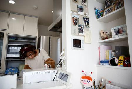 Kanako Hagiwara works in kitchen of her house at Higashinohara district in Inzai