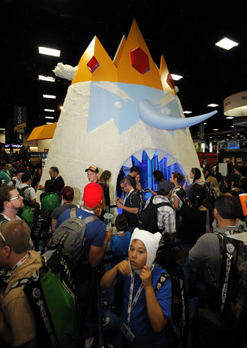 Fans wait to walk through a huge Ice King character at the Cartoon Network booth during the Preview Night event on Day 1 of the 2013 Comic-Con International Convention on Wednesday, July 17, 2013 in San Diego. (Photo by Denis Poroy/Invision/AP)