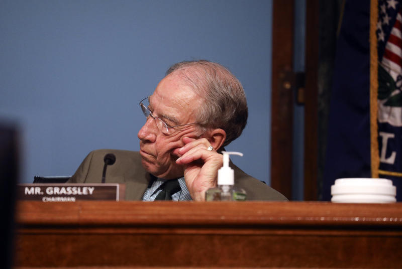 """Chairman Sen. Chuck Grassley, R-Iowa, listens during a Senate Finance Committee hearing on """"COVID-19/Unemployment Insurance"""" on Capitol Hill in Washington on Tuesday, June 9, 2020. (Leah Millis/Pool via AP)"""