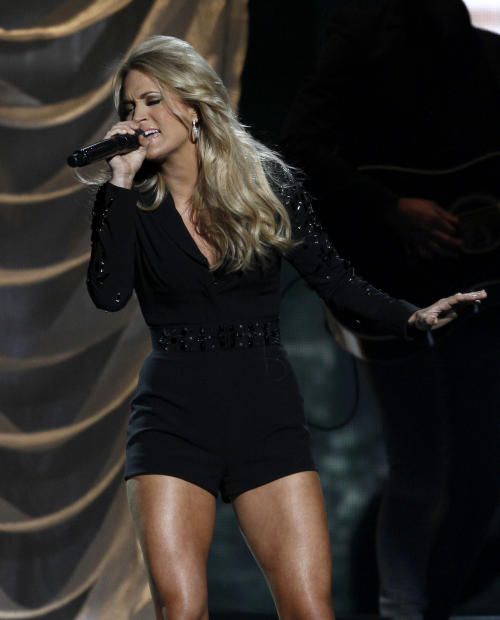 Carrie Underwood performs at the 47th annual CMA Awards at Bridgestone Arena on Wednesday, Nov. 6, 2013, in Nashville, Tenn. (Photo by Wade Payne/Invision/AP)
