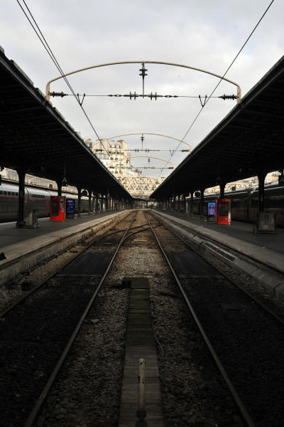An empty railway platform at the Gare de l'Est railway station, in Paris, Thursday, Dec. 26, 2019. France's punishing transportation troubles may ease up slightly over Christmas, but unions plan renewed strikes and protests in January to resist government plans to raise the retirement age to 64. (AP Photo/Thibault Camus)