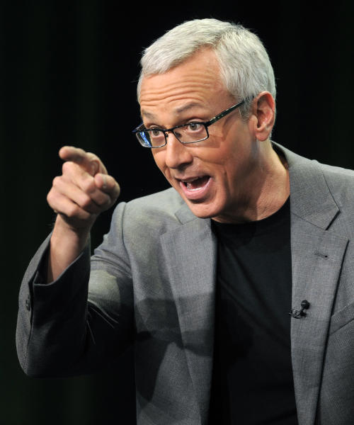 """FILE - This Aug. 4, 2011 file photo shows Dr. Drew Pinsky, host of the CW television series """"Dr. Drew's Lifechangers,"""" during a panel discussion on the show at the CW Showtime summer press tour in Beverly Hills, Calif. Criticism of Dr. Drew Pinsky spread on the Internet almost as quickly as news of Mindy McCready's death. The country singer with the tumultuous personal life became the fifth cast member of his """"Celebrity Rehab"""" series to die since appearing on the show and the third from Season 3. (AP Photo/Chris Pizzello, file)"""