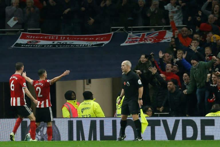 Buoyant Blades: George Baldock celebrates Sheffield United's equaliser at Tottenham