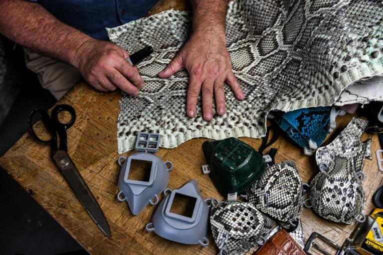 Brian Wood makes face masks from python skin in his workshop in Delray Beach, Florida