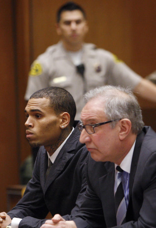 Singer Chris Brown, left, appears in court with his attorney Mark Geragos for a probation revocation hearing at the Criminal Justice Center in downtown Los Angeles on Wednesday, Feb. 6, 2013. Prosecutors are seeking probation revocation because they say they could not find credible evidence that Brown completed his community labor sentence stemming from the 2009 beating of his girlfriend Rihanna. (AP Photo/David McNew, Pool)