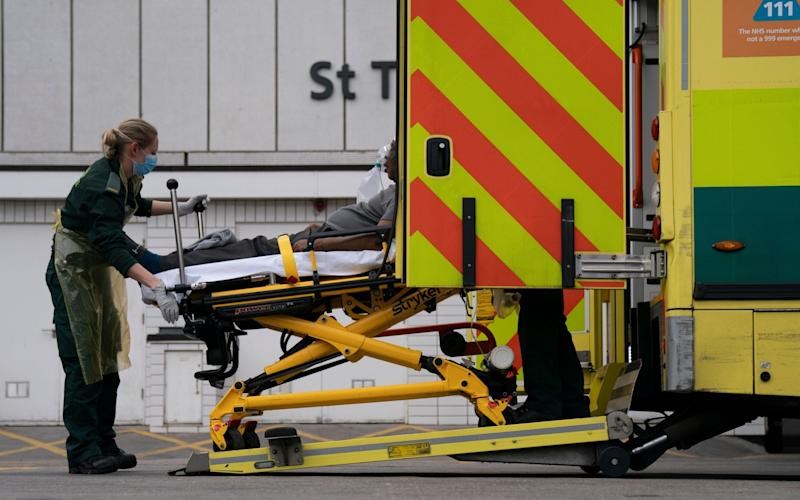 Paramedics outside St Thomas' Hospital, Central London - WILL OLIVER/Shutterstock