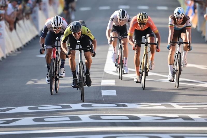 Team Mitchelton rider Slovenias Luka Mezgec 2ndL sprints to cross the finish line at the second place at the end of the 19th stage of the 107th edition of the Tour de France cycling race 160 km between BourgenBresse and Champagnole on September 18 2020 Photo by Marco BERTORELLO AFP Photo by MARCO BERTORELLOAFP via Getty Images