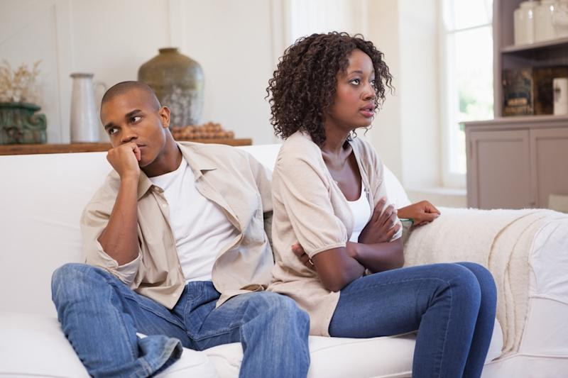 Couple ignoring each other on the couch during a fight