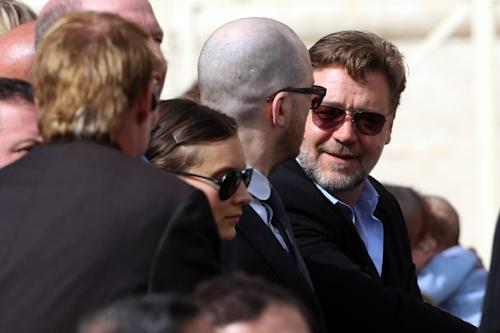 "Actor Russell Crowe, right, attends Pope Francis' general audience in St. Peter's Square at the Vatican, Wednesday, March 19, 2014. Crowe and the makers of the big-budget film ""Noah"" attended Pope Francis' general audience Wednesday but didn't get what they most wanted: a papal meeting and photo-op. Crowe had lobbied hard for a papal thumbs up for his film and the ensuing publicity a Francis blessing would bring. The film has been banned in much of the Muslim world because of its depiction of the prophet, while U.S. conservatives have complained it took liberties with the Biblical account of the flood. (AP Photo/Str)"