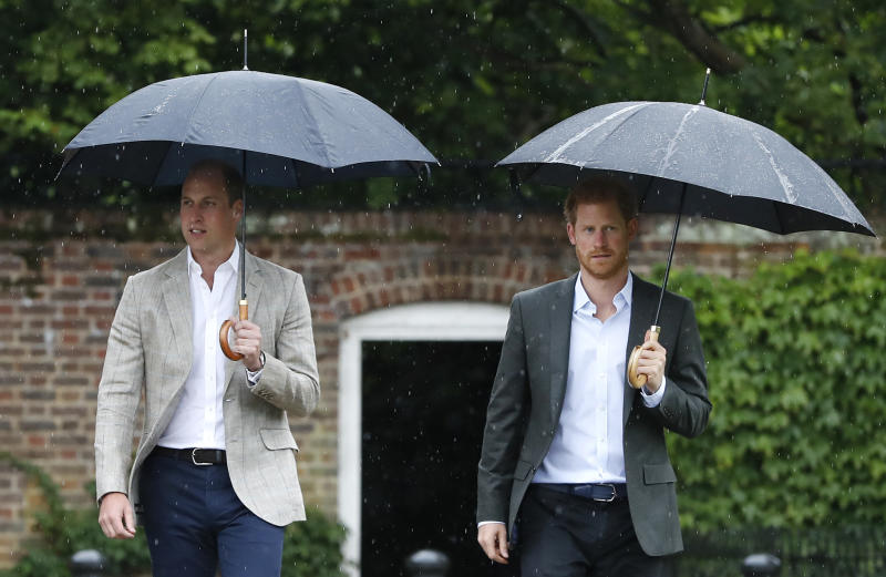 FILE  - In this Wednesday, Aug. 30, 2017 file photo, Britain's Prince William, left, and Prince Harry arrive for an event at the memorial garden in Kensington Palace, London. Britain's Queen Elizabeth II is set to hold face-to-face talks Monday, Jan. 13, 2020 with Prince Harry for the first time since he and his wife, Meghan, unveiled their controversial plan to walk away from royal roles — at a dramatic family summit meant to chart a future course for the couple. The meeting at the monarch's private Sandringham estate in eastern England will also include Harry's father Prince Charles and his brother Prince William. (AP Photo/Kirsty Wigglesworth, File)