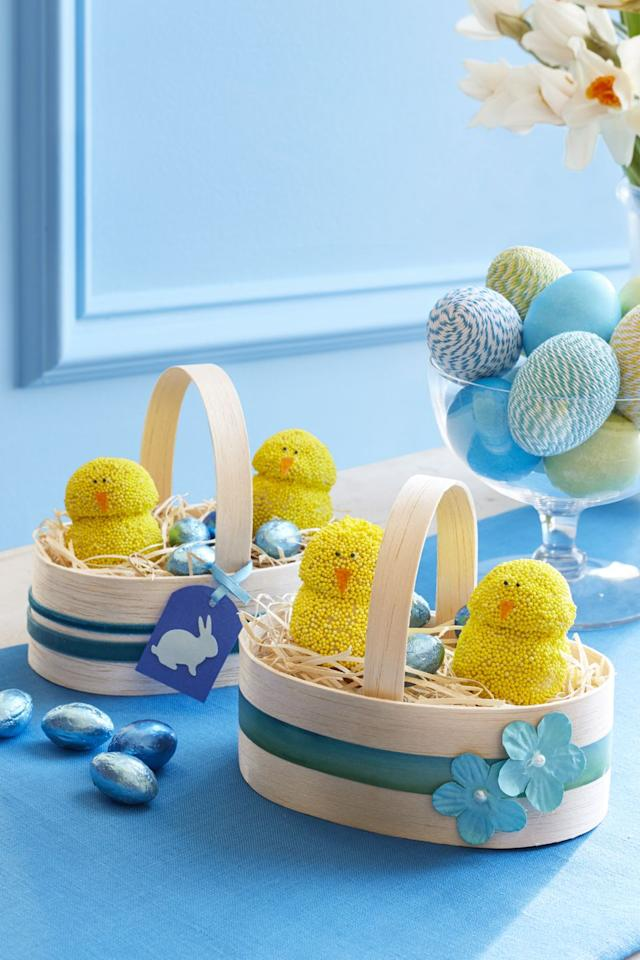 """<p>Stacked doughnut holes are transformed into adorable baby chicks your guests will swoon over. </p><p><strong><a href=""""https://www.womansday.com/food-recipes/food-drinks/recipes/a58152/spring-chickens-recipe/"""" target=""""_blank""""><em>Get the Spring Chickens recipe. </em></a></strong></p>"""