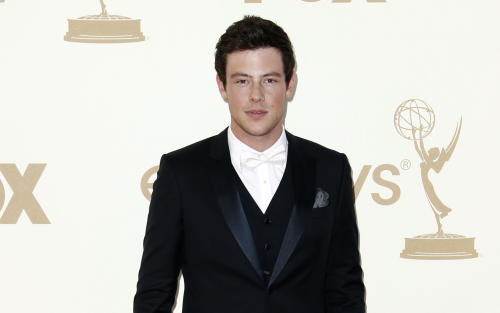 "FILE - In this Sept. 18, 2011 file photo, Cory Monteith arrives at the 63rd Primetime Emmy Awards, in Los Angeles. ""Glee"" launched its new season Thursday, Sept. 26, 2013, with the first episode of a two-part Beatles tribute. Lea Michele's character, Rachel, looks at a cell phone photo that includes a group shot with Monteith's character, Finn, in it. She sings the Beatles' ""Yesterday"" in the scene. (AP Photo/Matt Sayles, File)"