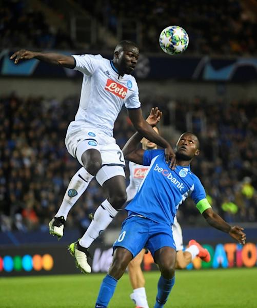 Napoli defender Kalidou Koulibaly (L) - a former Genk player - wins an aerial challenge as Samatta looks on. The sides drew 0-0 earlier this month in Belgium