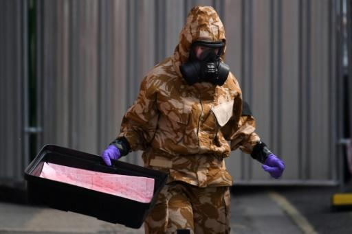 An investigator wearing a protective suit in the English town of Amesbury, where a couple were found in critical condistion after coming into contact with the Novichok nerve agent