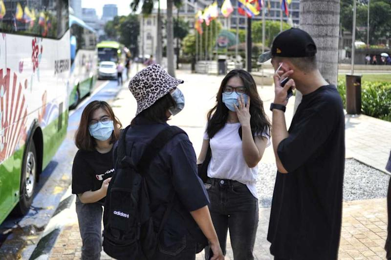 Tourists are seen wearing masks to protect themselves against the new coronavirus in Kuala Lumpur January 26, 2020. ― Picture by Shafwan Zaidon