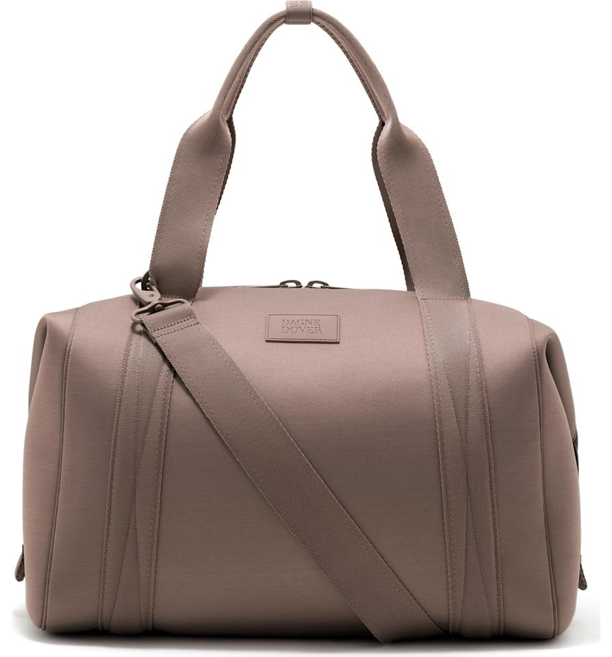 """<p>This <a href=""""https://www.popsugar.com/buy/Dagne-Dover-Large-Landon-Carryall-539633?p_name=Dagne%20Dover%20Large%20Landon%20Carryall&retailer=shop.nordstrom.com&pid=539633&price=185&evar1=fab%3Aus&evar9=46455050&evar98=https%3A%2F%2Fwww.popsugar.com%2Fphoto-gallery%2F46455050%2Fimage%2F46455060%2FDagne-Dover-365-Large-Landon-Carryall&list1=shopping%2Ctravel%2Ceditors%20pick%2Ctravel%20style&prop13=api&pdata=1"""" rel=""""nofollow"""" data-shoppable-link=""""1"""" target=""""_blank"""" class=""""ga-track"""" data-ga-category=""""Related"""" data-ga-label=""""https://shop.nordstrom.com/s/dagne-dover-365-large-landon-neoprene-carryall-duffle-bag/5327372/full?origin=category-personalizedsort&amp;breadcrumb=Home%2FBrands%2FDagne%20Dover&amp;color=dune"""" data-ga-action=""""In-Line Links"""">Dagne Dover Large Landon Carryall</a> ($185) is the latest addition to the collection. It features a strap on the back that you can connect to your suitcase.</p>"""