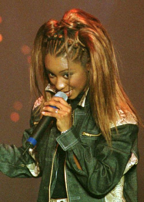 FILE - This April 29, 2000 file photo originally released by the Disney Channel shows R&B singer Natina Reed of the band Blaque during a concert at the Roxy in Atlanta. Reed was in a street when she was struck by a car and killed in Gwinnett County late Friday, Oct. 26, 2012. Police say the 32-year-old singer was struck and killed while in the roadway at an intersection on U.S. 29. Police say the driver wasn't at fault and no charges are being filed. . Investigators want to determine why Reed was in the road. (AP Photo/Disney Channel, Carolyn Kaster, file)