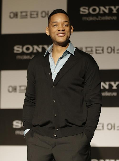 """FILE - In this Tuesday, May 7, 2013 file photo, U.S. actor Will Smith poses for the media during a press conference for his new film """"After Earth"""" in Seoul, South Korea. Smith and his son Jaden Smith are in Seoul to promote the film which is to be released in South Korea on May 30. The film, opening May 31 in the US, is set in a future where nature has turned on humans and survivors were forced to start a new civilization on another planet. (AP Photo/Lee Jin-man, File)"""