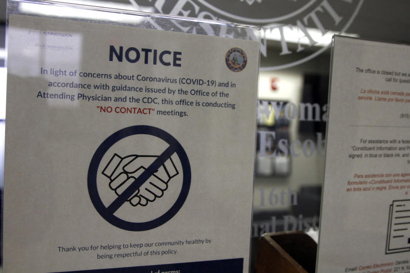 A notice on the door of Rep. Veronica Escobar, D-Texas, explains that it is closed to in-person visits on Wednesday, March 18, 2020, in El Paso, Texas. Inside, Escobar answered questions from constituents during in a virtual town hall about the coronavirus. (AP Photo/Cedar Attanasio)