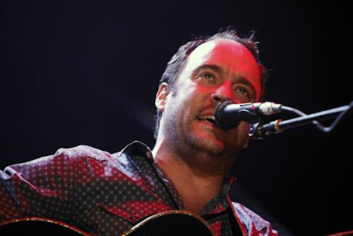 FILE - This Sept. 22, 2012 file photo shows Dave Matthews of the Dave Matthews Band performing during the Farm Aid 2012 concert at Hersheypark Stadium in Hershey, Pa. The band is giving $1 million to help Superstorm Sandy recovery efforts in New Jersey and New York. They announced Wednesday, Nov. 14, that the Nov. 30 opening show of their tour at the IZOD Center in East Rutherford, N.J., will be a benefit concert. All tickets and merchandise sales will go to the Bama Works Sandy Relief Fund, established at the Community Foundation of New Jersey. (AP Photo/Jacqueline Larma, file)