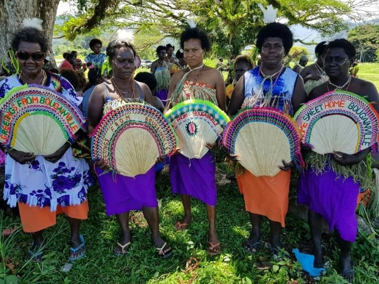 Women in tribal colours take part in a reconciliation ceremony -- part of efforts to ensure a brighter future for Bougainville