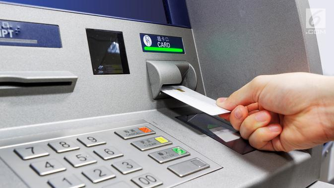 Ilustrasi Foto Mesin ATM (Anjungan Tunai Mandiri) (iStockphoto)