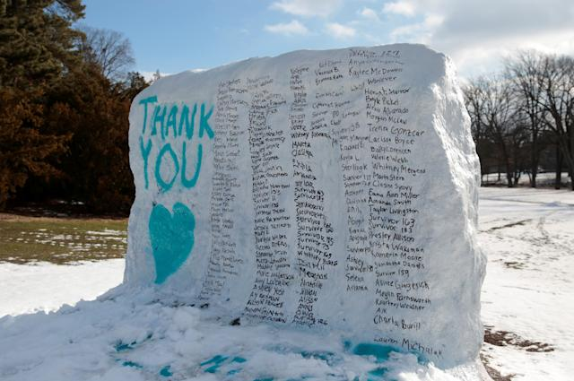 A boulder on the campus of Michigan State University is painted with the names of assault victims of Larry Nassar. (Rebecca Cook / Reuters)