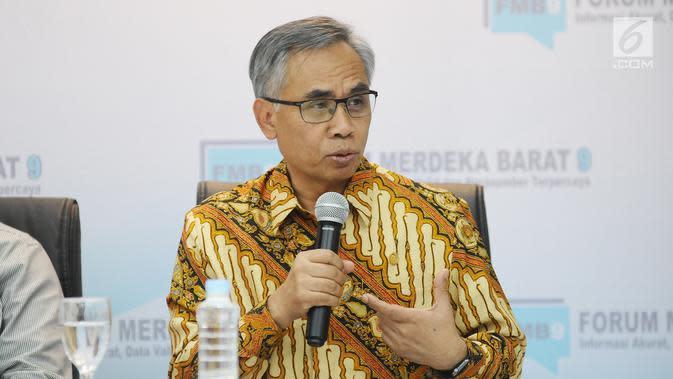 Ketua Dewan Komisioner OJK Wimboh Santoso saat diskusi FMB 9 bertajuk 'Investasi Unicorn untuk Siapa?', Jakarta (26/2). Potret e-commerce dan start-up Indonesia diyakini akan menjadi saran lompatan besar untuk Indonesia. (Liputan6.com/Herman Zakharia)