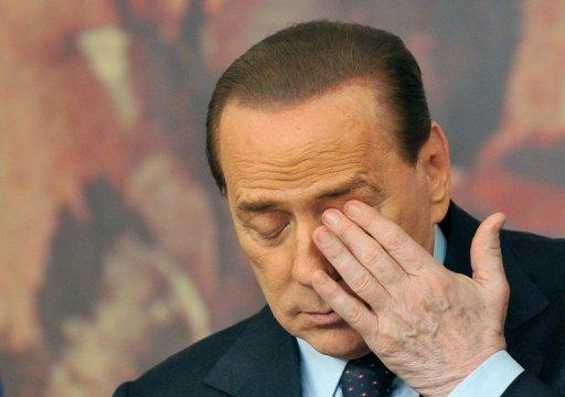 """Ex-premier Silvio Berlusconi, seen here in February 2011, accused an Italian magazine on Friday of violating his privacy by publishing """"illicit"""" photos of female guests at his villa under the title """"Berlusconi's harem"""""""
